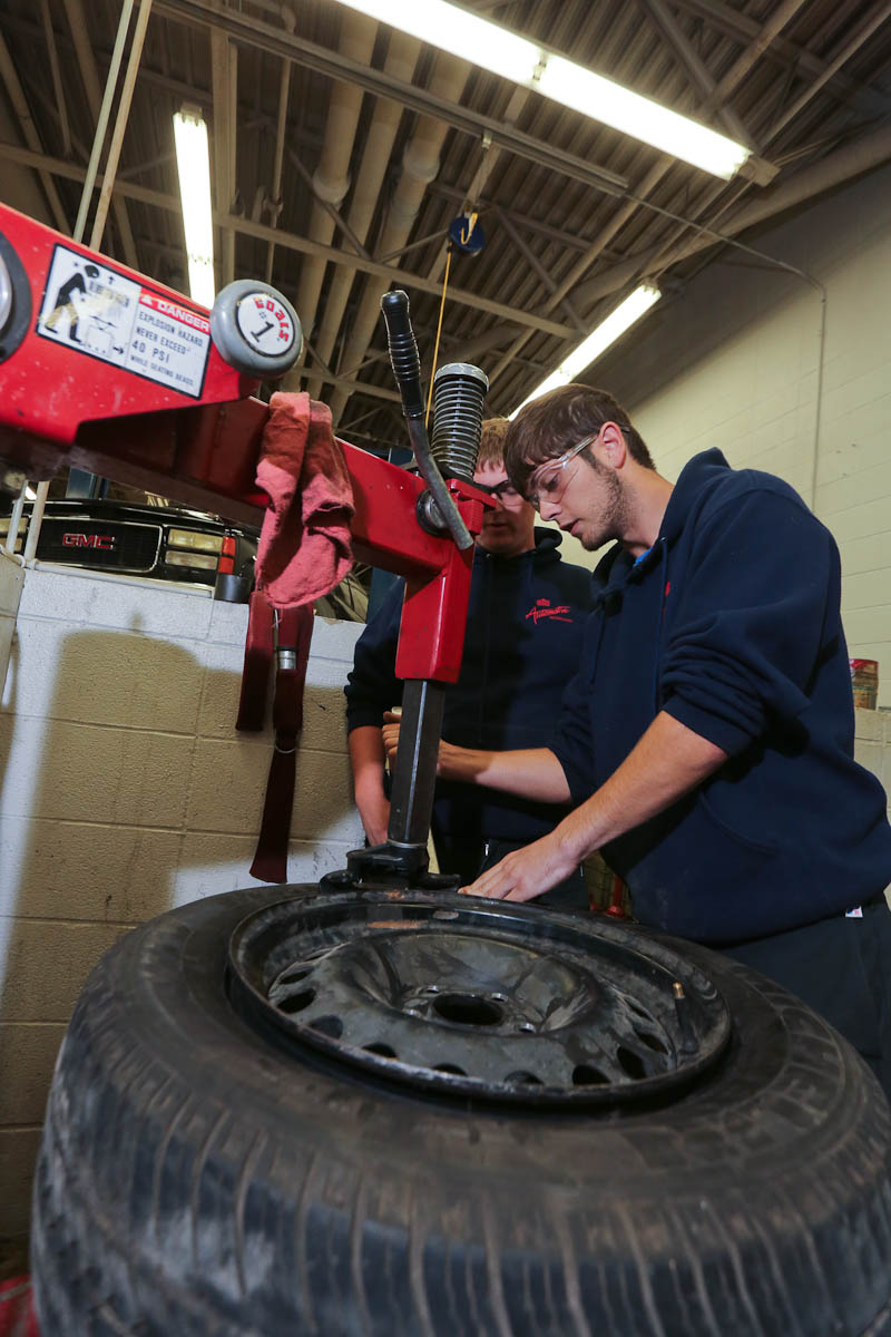 Picture of Student fixing tire