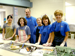 Picture of  a group serving meals at Community Kitchen