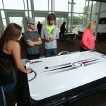Picture of students playing air hockey