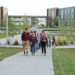Picture of students walking from housing complex