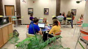 Photo of a students lounging in Cafe Bean in the Beem Center