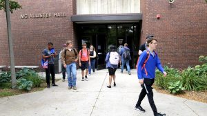 Photo of students exiting the McAllister Hall Building