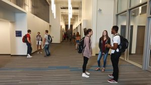 Photo students in the hallways of the STEM Center