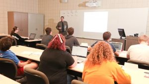 Photo students in a McAllister Hall classroom
