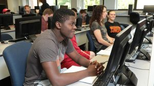 Photo students in a computer lab in McAllister Hall
