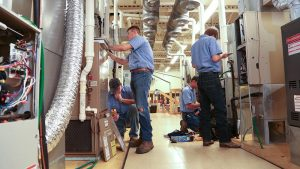 Photo of students working on HVAC systems