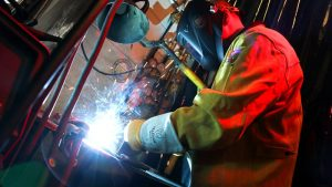 Photo of a student welding