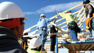 Photo of students constructing a building for the Building Trades program