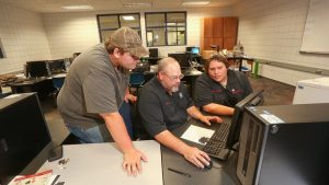 Photo of students working in a CAD lab