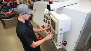 Photo of student working machinery in Tool & Die program