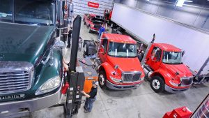Photo of students working on trucks in the Diesel Technology Center