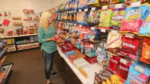 Photo of student shopping the convenient store located in student housing