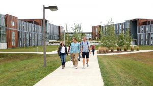 Photo of students walking to campus from the Campus View Housing complex
