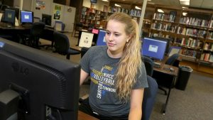 Photo of a student using a computer in the Beem Center library