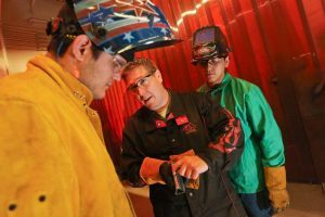 Picture of students learning welding techniques