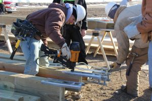 Picture of Building Trades students working on house