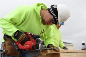 Picture of Building Trades student cutting lumber