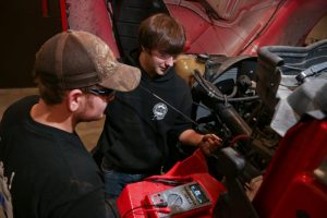 Picture of Diesel students working on Truck