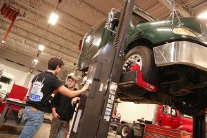 Picture of Diesel students working on Semi Truck