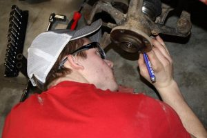 Picture of automotive student working on car