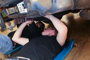 Picture of Automotive students working on car