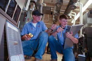 Picture of students working on HVAC unit