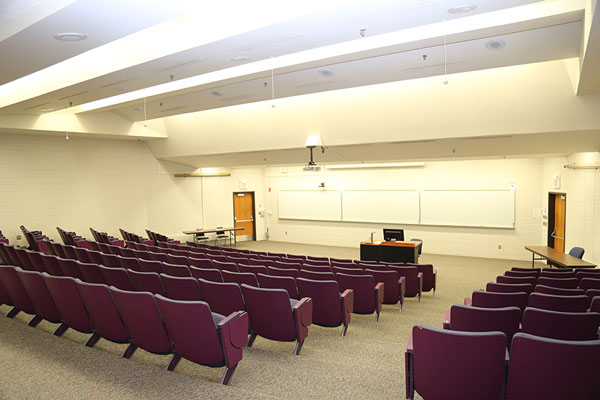 Photo from the back of meeting room BC200 featuring theater style seating