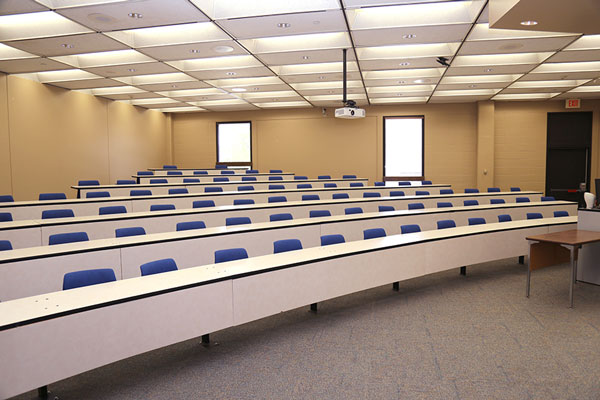 Photo of meeting room MH104G showing seating and desk layout