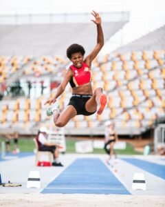 Picture of Rellie Kaputin in the middle of a Long Jump